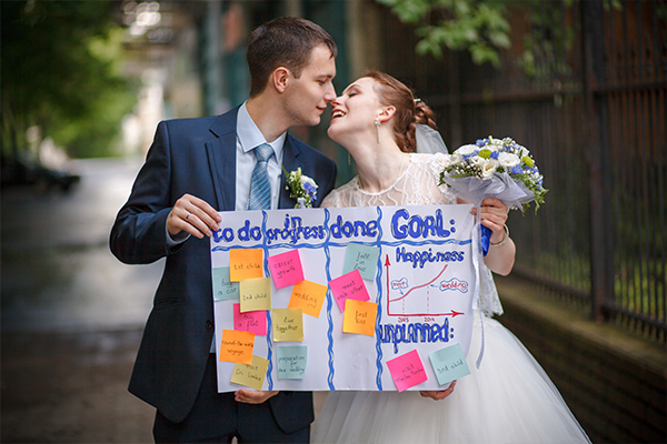 Wedding couple holding a completed to do list