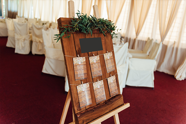 A seating chart at a wedding reception