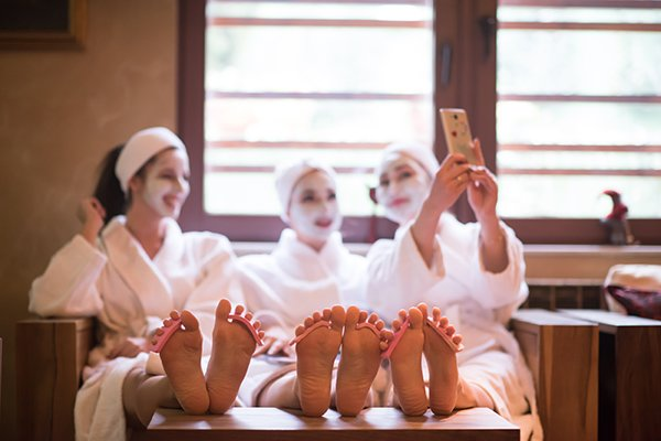 Three women relax at a spa